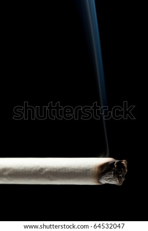Addiction issue - smoking cigarette black isolated - stock photo