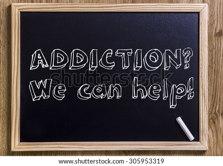 ADDICTION? We can help! - New chalkboard with outlined text - on wood - stock photo