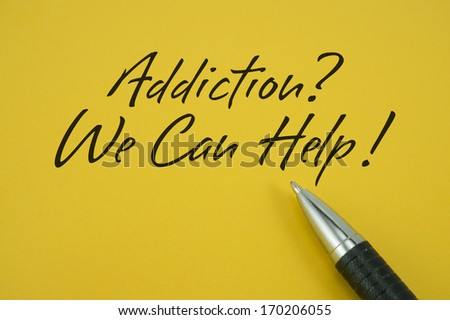 Addiction? We Can Help! note with pen on yellow background - stock photo