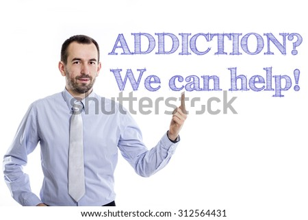 ADDICTION? We can help! - Young businessman with small beard pointing up in blue shirt - stock photo