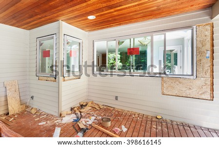 Adding windows during a kitchen remodel - installing into framed holes - stock photo
