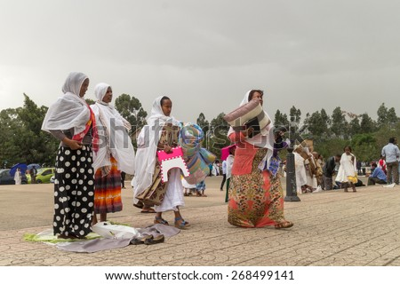 Addis Ababa: April 10: Devoted Ethiopian Orthodox followers observe Siklet, the crucifixion of Jesus Christ, at Bole Medhane Alem Church on April 10 ,2015 in Addis Ababa, Ethiopia - stock photo