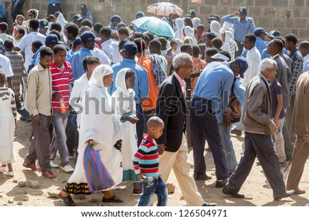 ADDIS ABABA, ETHIOPIA - JANUARY 19: The local police conducting a pat-down search on the hundreds of thousands of people attending Timket celebrations of Epiphany, on January 19, 2013 in Addis Ababa, Ethiopia. - stock photo