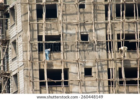 ADDIS ABABA, ETHIOPIA - MARCH 05, 2010: Unidentified men on a construction site work on a building in the center of Addis Ababa.  - stock photo
