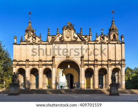 Addis Ababa, Ethiopia - October 10th 2015 - The Holy Trinity Cathedral in downtown Addis Ababa in Ethiopia with a nice blue sky background. - stock photo