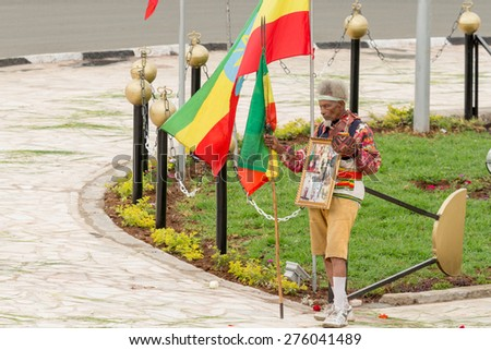 Addis Ababa - May 5: Arbegna, a patriot and war veteran, holds the Ethiopian flag at the 74th anniversary of Patriots' Victory day on May 5, 2015 in Addis Ababa, Ethiopia. - stock photo