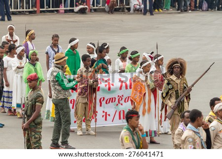 Addis Ababa - May 5: Children march at the 74th anniversary of Patriots' Victory day commemorating the defeat of the invading Italians on May 5, 2015 in Addis Ababa, Ethiopia. - stock photo