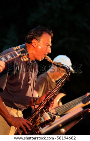 ADDISON, TX - JULY 31 : Saxophone player of John Adams Group performs at July Jazz event on July 31, 2010 in Addison, TX - stock photo