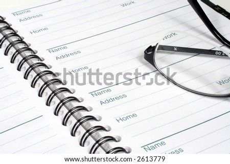 Address Book and Glasses - stock photo
