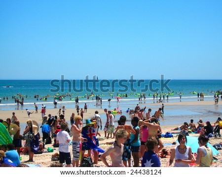 ADELAIDE, AUSTRALIA - JANUARY 26: Glenelg beach was crowed with lots of people on Australia day, January 26, 2009. Participants of the Havaianas World Record Attempt also came ashore. The beach is located in Adelaide, Australia.