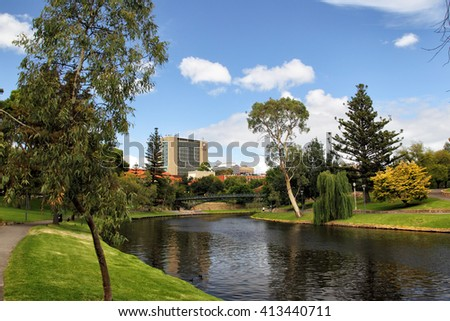 ADELAIDE, AUSTRALIA - JANUARY 25, 2015: River Torrens flowing through green parks in Adelaide city.