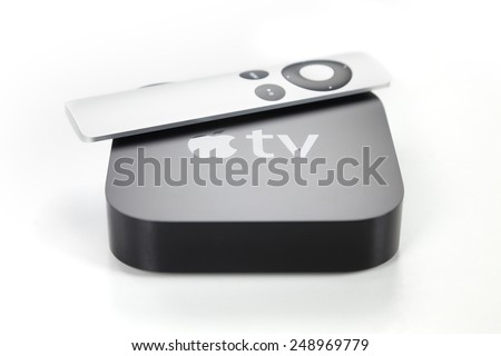 Adelaide, Australia - January 27, 2015: View of a third generation Apple TV and its remote control. The Apple TV is a digital media player developed by Apple Inc - stock photo