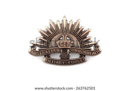 ADELAIDE, AUSTRALIA - MARCH 18, 2015: Australian Anzac WWI rising star hat badge on white background. - stock photo