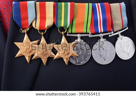 ADELAIDE, AUSTRALIA - MARCH 18, 2016: Australian Army WWII medals with the 1939 - 1945 Star, Africa Star, Pacific Star, Defence Medal, 1939 -1945 Medal and Australian Service Medal, with copy space. - stock photo
