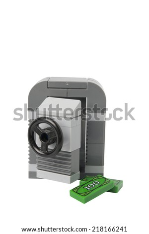 ADELAIDE, AUSTRALIA - September 11, 2014: A studio shot of a Lego safe and money. Lego is a very popular product with children and collectors worldwide. - stock photo