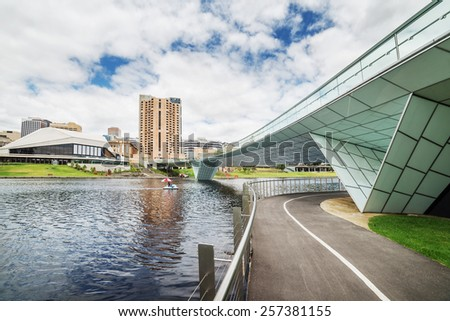 Adelaide downtown view from river Torrens at cloudy noon - stock photo