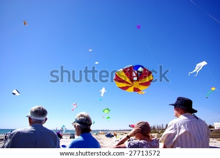 ADELAIDE - MARCH 29: Visitors at Adelaide International Kite Festival at Semaphore Beach March 29, 2009 in Adelaide, Australia. The festival managed to attract an estimated 10,000 visitors. - stock photo