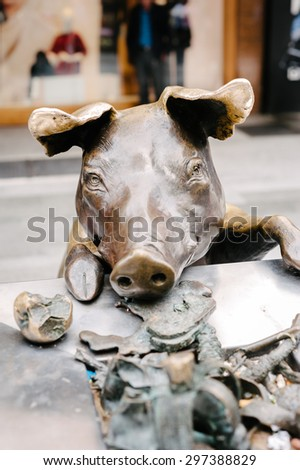 ADELAIDE, SA, AUSTRALIA - April 13, 2015: the famous bronze pig sculptures on Rundle Mall.  - stock photo