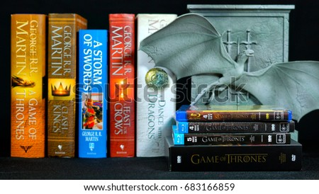 ADELAIDE, SOUTH AUSTRALIA - JULY 12, 2017: Popular fantasy hardcover books, A Song of Ice and Fire, by George R R Martin, with Game of Thrones dragon cover DVD collection, front focus.