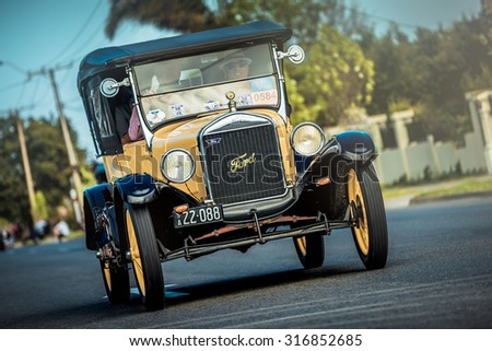 Adelaide, South Australia - September 28, 2014: Old Ford T car with people on board is driving on the street during the Bay to Birdwood car run.