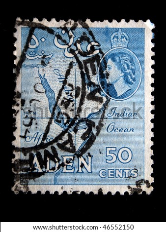 ADEN - CIRCA 1954: Image of British Queen Elisabeth on stamp printed in Aden with amp of this country. Aden became a crown colony of the UK in 1954. Circa 1954