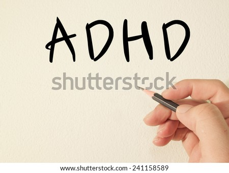 ADHD text concept write on wall  - stock photo