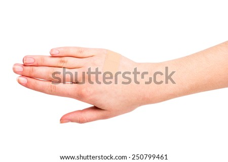 Adhesive Bandage. Close-up hand of young woman with a adhesive bandage. - stock photo