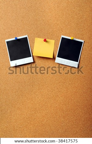 Adhesive note pad with vintage photographs pinned to cork board with copyspace - stock photo