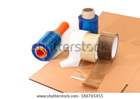 Adhesive tapes for packaging, nylon, cardboard on white background - stock photo