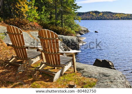 Adirondack chairs at shore of  Lake of Two Rivers, Ontario, Canada - stock photo