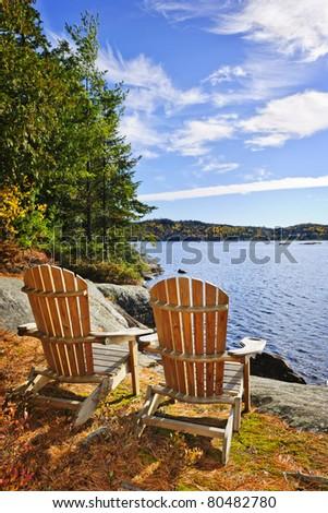 Adirondack chairs at shore of  Lake of Two Rivers, Ontario, Canada - stock photo