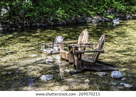 Adirondack chairs in the Big Sur river, near Carmel.  CA. on the California Central Coast. - stock photo
