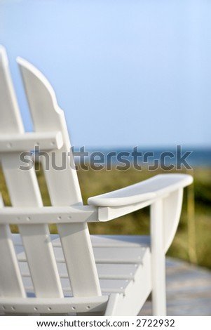 Adirondack Chairs On Deck Looking Towards Beach On Bald Head Island, North  Carolina.