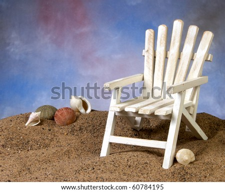 Adirondack on the beach with seshells in the background - stock photo