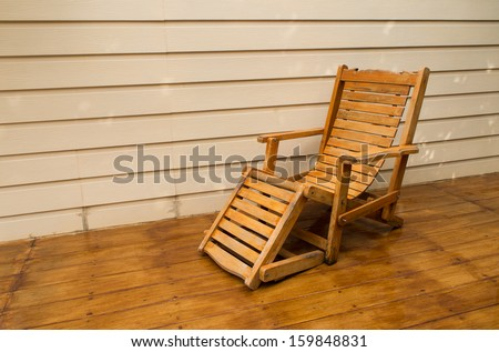 Adirondack wood chairs on a cabin porch - stock photo