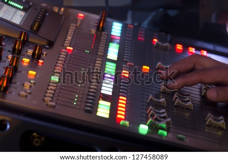 Adjust sound mixer switch in concert - stock photo