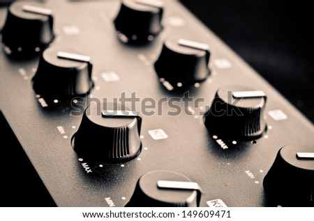 adjustable knobs on a DJ mix tool - stock photo