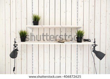 adjustable shelves on wooden plank wall - stock photo