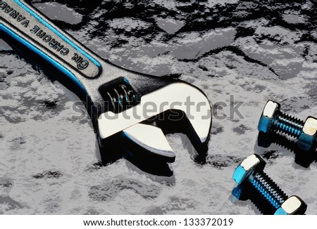 Adjustable wrench, nuts and bolts as concept of adjusting/adapting to changes in a business environment. - stock photo