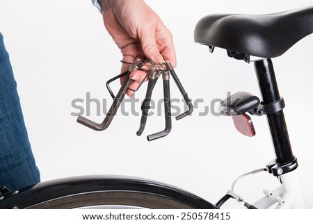 Adjustment and repair of the bike with the allen key - studio shoot