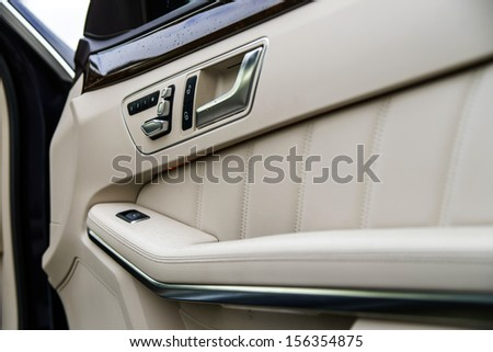 Adjustment handles in town car. Ivory luxury interior - stock photo