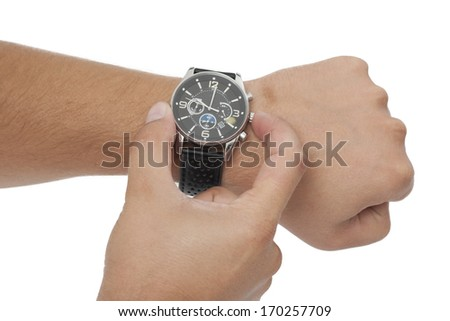 adjustment of the watch on white background - stock photo