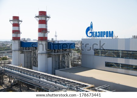 ADLER, RUSSIA - JUNE 26, 2013: Gazprom company logo on the roof of thermal power plant. - stock photo
