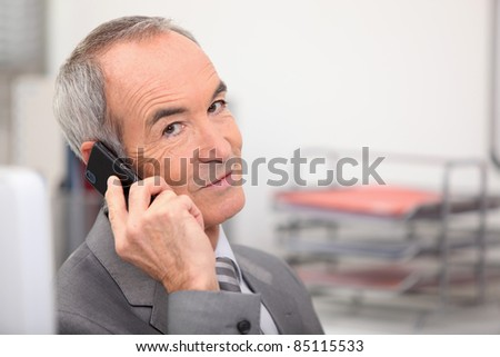 Admin worker with mobile telephone - stock photo