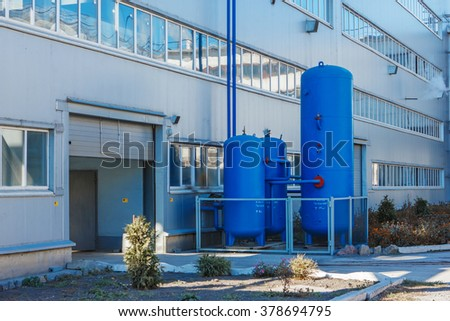 Administrative or industrial building with three air collector plant for the production of sugar from sugar beet - stock photo
