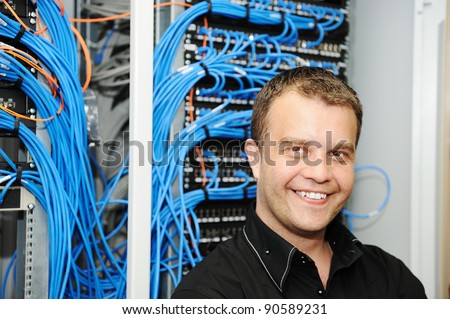 Administrator at server room - stock photo