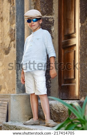 Admiring little boy laughing outdoors - stock photo