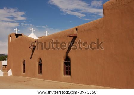 Adobe church at Taos Pueblo in Taos, New Mexico - stock photo