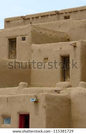 Adobe houses at Taos Pueblo, New Mexico USA - stock photo