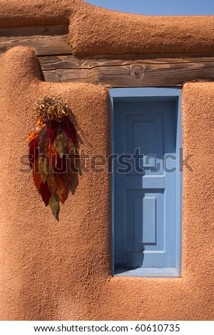 Adobe shuttered window at Rancho de Taos in New Mexico - stock photo